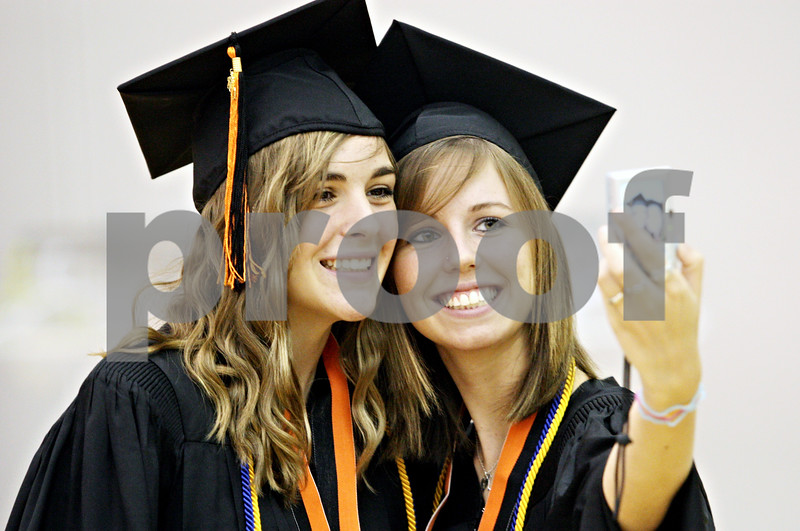 Rob Winner – rwinner@daily-chronicle.com<br /> <br /> DeKalb High School graduating seniors Nicole Billups (left) and Mackenzie Maeder photograph themselves before their commencement ceremony at the Convocation Center in DeKalb, Ill. on Saturday June 6, 2010.