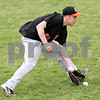 Beck Diefenbach  -  bdiefenbach@daily-chronicle.com<br /> <br /> DeKalb's Ben Dallesasse (15) fields a ground ball during the first inning of the game against Sycamore at Sycamore Park in Sycamore, Ill., on Thursday April 8, 2010.