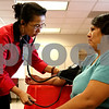 Rob Winner – rwinner@daily-chronicle.com<br /> <br /> Registered nurse Xuyen Do (left) checks the blood pressure of DeKalb resident Marbella Lopez at the DeKalb County Health Department in DeKalb, Ill. on Tuesday September 14, 2010 during a free public education heart health campaign sponsored by Kishwaukee Community Hospital.