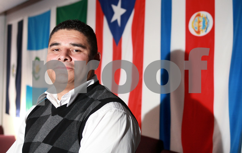 Kyle Bursaw - kbursaw@daily-chronicle.com<br /> <br /> Rodrigo Azofeifa is the pastor at Vida Nueva Church at 316 N. Sixth street. The congregation has members from 21 countries and each country is represented with a flag on the wall.