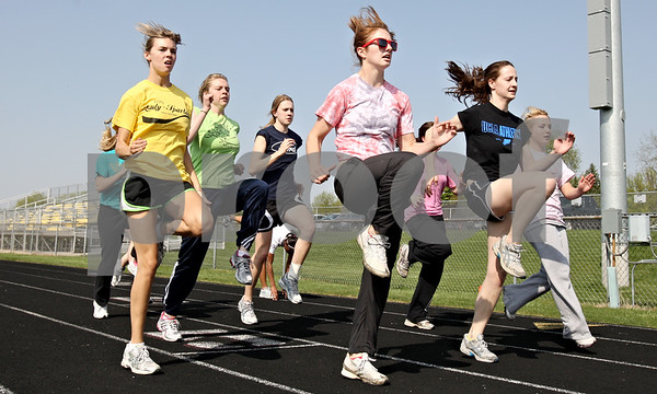 Rob Winner – rwinner@daily-chronicle.com<br /> <br /> Members of the girls track team warm up during practice in Sycamore, Ill. on Thursday April 22, 2010.