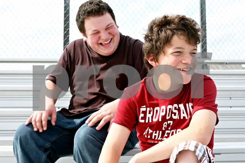 Rob Winner – rwinner@daily-chronicle.com<br /> <br /> Alex Wagner (left) and his brother Eli Wagner, 15, create online promotional videos for the Genoa-Kingston football team.<br /> <br /> Genoa, Ill. <br /> Thursday September 23, 2010