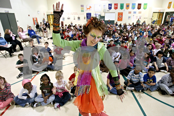 """Rob Winner – rwinner@daily-chronicle.com<br /> <br /> Guest artist Jane Bredendick, of Marshfield, Wisconsin, dances during an assembly at Gwendolyn Brooks Elementary School in DeKalb, Ill. on Tuesday March 30, 2010. Brooks Elementary is celebrating Fine Arts Week and their theme is """"Under the Sea."""""""