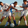 Beck Diefenbach – bdiefenbach@daily-chronicle.com<br /> <br /> Genoa-Kingston's Ulyses Parra (15, left) and Erick Beltran (8, right) try to keep the ball away from Rockford Christian's Cody Mech (20, center) during the second half of the game at G-K High School in Genoa, Ill., on Thursday Sept. 30, 2010. G-K defeated Rockford Christian 1 to 0.