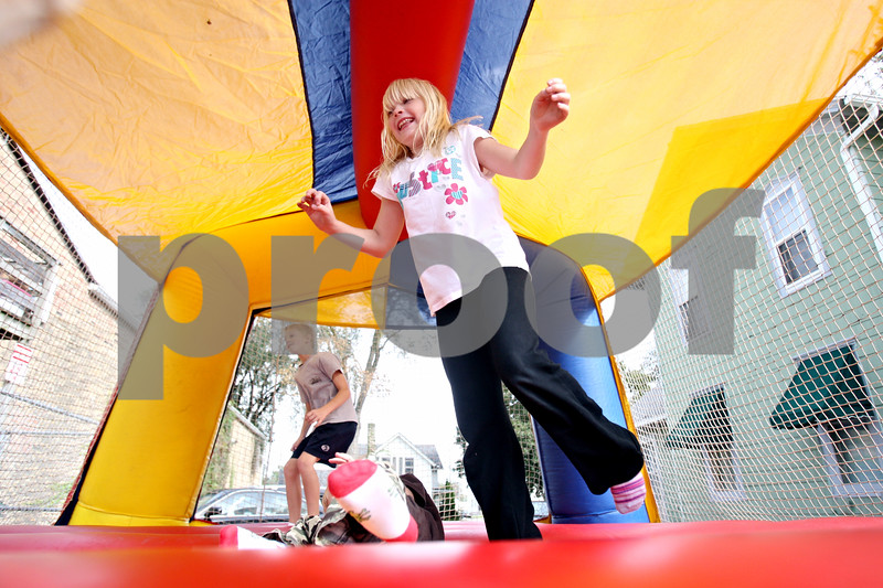 Rob Winner – rwinner@daily-chronicle.com<br /> <br /> Paige Breeding, 7 of Minnesota, jumps around an inflatable bouncer during the Harvest Moon Festival in Genoa, Ill. on Saturday September 25, 2010.