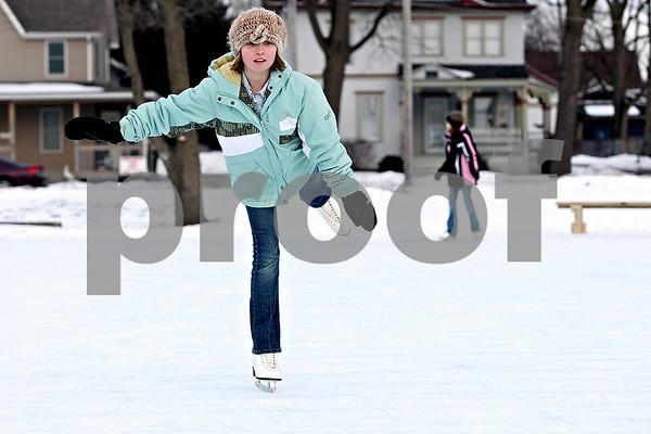 Rob Winner – rwinner@daily-chronicle.com<br /> Autumn Routson, 10, skates at the Genoa Community Ice Rink in Genoa, Ill on Saturday January 30, 2010.