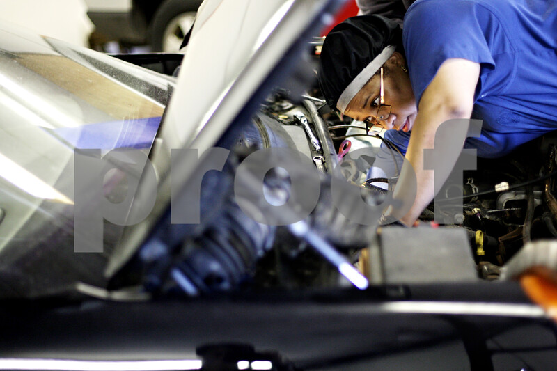 Beck Diefenbach  -  bdiefenbach@daily-chronicle.com<br /> <br /> Monica O'Leary works to repair a Pontiac Aztec's engine in her shop at 1211 S 4th St. in Dekalb, Ill., on Friday May 28, 2010.