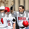 Beck Diefenbach  -  bdiefenbach@daily-chronicle.com<br /> <br /> Northern Illinois' Joe Etcheverry (5) is congratulated after hitting a two run home run during the second inning of the game against Ohio at NIU in DeKalb, Ill., on Friday April 16, 2010.