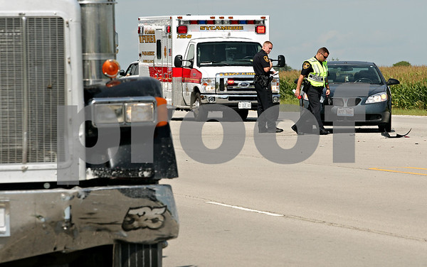 Beck Diefenbach - bdiefenbach@daily-chronicle.com<br /> <br /> DeKalb County Sheriff Deputies inspect a vehicle after it collided with a semi-trailer on Peace Road at Wirsing Parkway in DeKalb, Ill., on Wednesday Aug. 18, 2010.