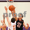 Beck Diefenbach - bdiefenbach@daily-chronicle.com<br /> <br /> DeKalb's Jordan Threloff blocks a shot by Oswego's Ryan West (11) during the fourth quarter of the sectional championship game at Hampshire High School in Hampshire, Ill., on Friday March 12, 2010. Oswego defeated DeKalb 57 to 51, ending the Barb's season.