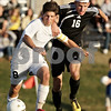 Rob Winner – rwinner@daily-chronicle.com<br /> <br /> Kaneland's Alex Gil (left) and Sycamore's Adam Westerby chase after a ball during the second half of their IHSA Class 2A Sycamore Regional semifinal on Wednesday October 20, 2010 in Sycamore, Ill. Kaneland went on to defeat Sycamore, 2-1.