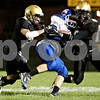 Rob Winner - rwinner@daily-chronicle.com<br /> <br /> Sycamore's Brandon Larsen (left) and Anthony Patitu (right) tackle Burlington Central's Zach Ranney during the second quarter of their game in Sycamore, Ill. on Friday September 3, 2010.