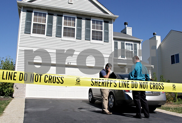 Beck Diefenbach – bdiefenbach@daily-chronicle.com<br /> <br /> Sheriff's deputies stand outside the site of a home invasion at 67 E Daisy Avenue in Cortland, Ill., on Tuesday Sept. 28, 2010.