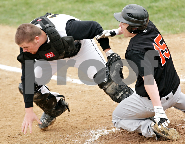 Beck Diefenbach  -  bdiefenbach@daily-chronicle.com<br /> <br /> DeKalb's Ben Dallesasse (15, right) slides safe into home as Sycamore catcher Alex Schultz (18, left) loses the ball throws the ball during the first inning of the game at Sycamore Park in Sycamore, Ill., on Thursday April 8, 2010.
