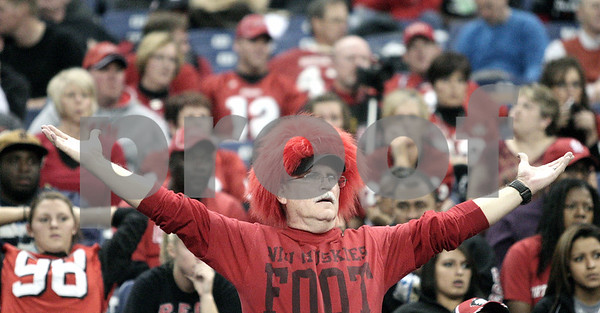 Kyle Bursaw – kbursaw@daily-chronicle.com<br /> <br /> An NIU fan reacts to a lost Huskie fumble in the second half of the MAC Championship game. The Miami (Ohio) Redhawks defeated the Northern Illinois Huskies 26-21at Ford Field in Detroit, Mich. on Friday, Dec. 3, 2010.