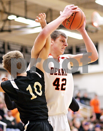 Beck Diefenbach - bdiefenbach@daily-chronicle.com<br /> <br /> Sycamore's Adam Schmitt (10, left) gets tangled up with DeKalb's Jordan Threloff (42) during the second quarter of the IHSA Class 3A regional semifinal game against Sycamore at Kaneland High School in Maple Park, Ill., on Tuesday March 2, 2010.
