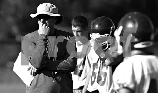 Rob Winner – rwinner@daily-chronicle.com<br /> <br /> Coach Bill McCarty watches his team's play on the field during the Cogs' morning practice on Thursday August 12, 2010 in Genoa, Ill.