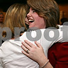 Rob Winner – rwinner@daily-chronicle.com<br /> At the DeKalb Elks Lodge on Tuesday night, democratic states attorney Sarah Gallagher Chami (right) hugs long-time friend Maggie Peck after Gallagher Chami received a call from a conceding John Farrell.