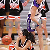 Beck Diefenbach  -  bdiefenbach@daily-chronicle.com<br /> <br /> DeKalb's Rachel Torres (34, left) tries to pass the ball after tripping over Hampshire's Cassie Dumoulin (24, right) during the first quarter of the IHSA Class 3A Regional championship game at Rochelle Township High School in Rochelle, Ill., on Thursday Feb. 18, 2010.