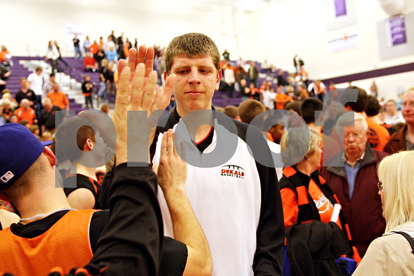 Beck Diefenbach - bdiefenbach@daily-chronicle.com<br /> <br /> DeKalb's Jordan Threloff gives a fan a high-five after loosing to Oswego in the sectional championship game at Hampshire High School in Hampshire, Ill., on Friday March 12, 2010. Oswego defeated DeKalb 57 to 51, ending the Barb's season.