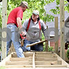 Rob Winner – rwinner@daily-chronicle.com<br /> <br /> Dan Steffa (left), of Malta, and Dick Zenzen, of DeKalb, help build a ramp for fellow Mason, Don Seitzinger, at his home in DeKalb, Ill. on Saturday May 1, 2010.