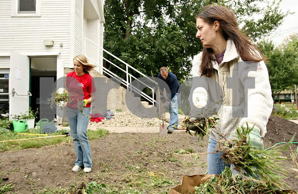 Rob Winner – rwinner@daily-chronicle.com<br /> <br /> Day of Caring volunteers, including Kelley Grosshuesch (from front to back), Ahna Young and Jason Nicol, clear weeds from the yard in front of the DeKalb Area Women's Center in DeKalb, Ill. for a rain garden on Thursday September 16, 2010.