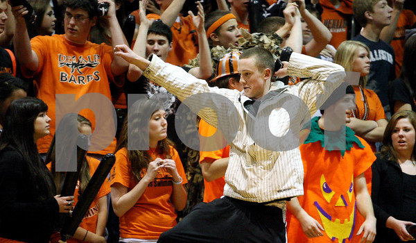 Rob Winner – rwinner@daily-chronicle.com<br /> A DeKalb fan dances along the sidelines as the Barbs take control during the second half on Saturday February 20, 2010 in DeKalb, Ill.