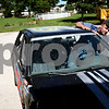 Beck Diefenbach  -  bdiefenbach@daily-chronicle.com<br /> <br /> Chad Askeland gets in his race car before heading to the Sycamore Speedway on Friday July 2, 2010. Askeland is the current point leader in the Compact Combat division.
