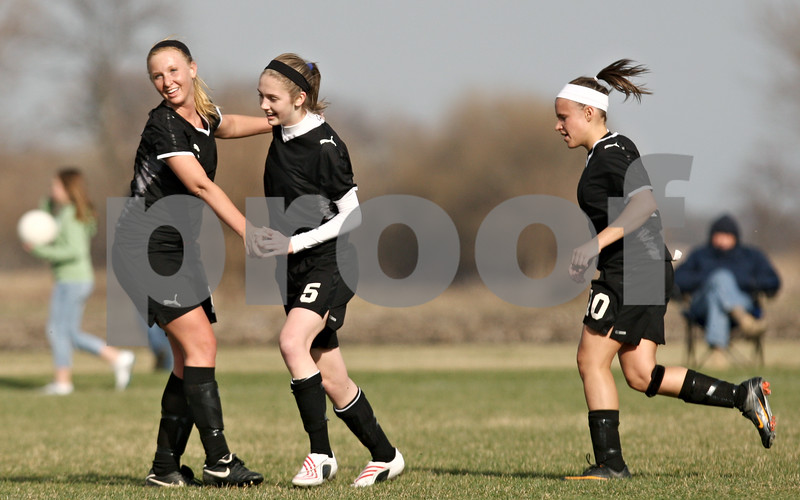 Rob Winner – rwinner@daily-chronicle.com<br /> <br /> Sycamore's Lindsey Hemmerich (left) congratulates Lauren Miller after her goal during the first half in Maple Park, Ill., on Wednesday, April 6, 2011. Sycamore defeated Kaneland, 4-1.