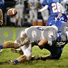 Rob Winner – rwinner@shawmedia.com<br /> <br /> Burlington Central's Chandler Crary (13) sacks Genoa-Kingston quarterback Adam Price to force a fumble during the second quarter in Genoa, Ill. on Friday, Sept. 30, 2011.