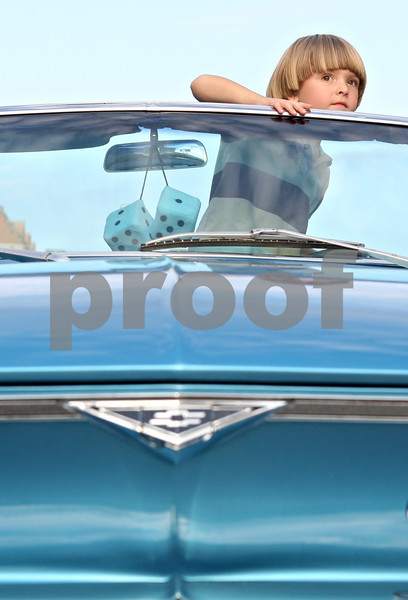 Rob Winner – rwinner@daily-chronicle.com<br /> <br /> 5-year-old Jamie Deegan-Warkins, of DeKalb, looks out the top of his father's 1966 Chevy Corvair before the start of the Kishwaukee Fest Parade on Friday, July 29, 2011, in downtown DeKalb, Ill.