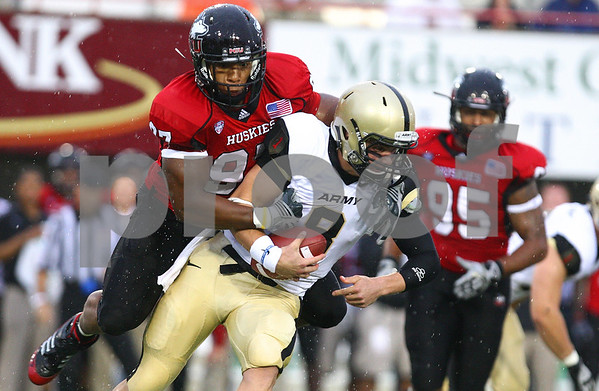 Kyle Bursaw – kbursaw@shawmedia.com<br /> <br /> Northern Illinois defensive end Joe Windsor (97) sacks Army quarterback Trent Steelman during the first quarter at Huskie Stadium in DeKalb, Ill. on Saturday, Sept. 3, 2011.