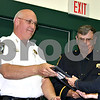 Jeff Engelhardt – Cortland Police Chief Dennis Medema hands officer Kimberly Everhart a plaque during her Medal of Valor ceremony at the Cortland Town Hall meeting Monday. Everhart earned the national award for saving two people in a July shooting.