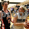 Kyle Bursaw – kbursaw@shawmedia.com<br /> <br /> Kaneland's Ashley Prost looks to pass during as DeKalb's Emily Bemis defends during the second quarter of their game at Kaneland High School on Tuesday, Dec. 13, 2011.