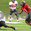 Kyle Bursaw – kbursaw@daily-chronicle.com<br /> <br /> Northern Illinois cornerback Rashaan Melvin (11) chases down a teammate in possession of the ball during the spring game on Saturday, April 23, 2011.