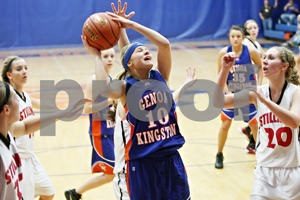 Rob Winner – rwinner@daily-chronicle.com<br /> <br /> Genoa-Kingston's Ashley Miller is fouled during the third quarter of the IHSA Class 2A Genoa-Kingston Regional on Tuesday, Feb. 8, 2011. Genoa-Kingston was defeated by Stillman Valley, 52-45.