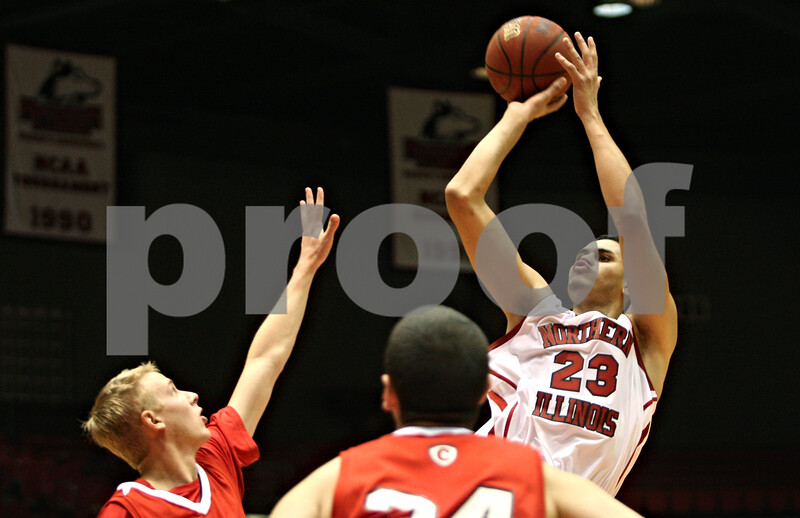 Rob Winner – rwinner@shawmedia.com<br /> <br /> Abdel Nader (23) of Northern Illinois puts up two over Carthage's Max Cary (12) and Nick Bauch (24) during the first half of their game in DeKalb, Ill., on Friday, Nov. 4, 2011.