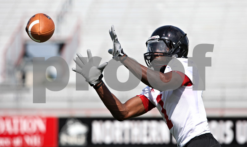 Rob Winner – rwinner@daily-chronicle.com<br /> <br /> Martel Moore reaches for a ball during practice at Huskie Stadium in DeKalb, Ill. on Thursday, Aug. 4, 2011.
