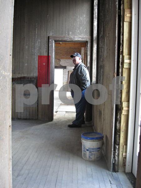 Bill Cummings of DeKalb walks around the historic train depot Thursday at the corner of Sacramento Street and DeKalb Avenue in Sycamore. The DeKalb County Community Foundation is in the planning stages of renovating the depot for its use.<br /> <br /> Caitlin Mullen - cmullen@shawmedia.com