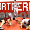 Kyle Bursaw – kbursaw@shawmedia.com<br /> <br /> Ryan Ludwig, head coach of NIU's wrestling team, looks on as his players practice on Tuesday, Dec. 13, 2011. Ludwig spent six years as an assistant at NIU before taking the reigns this season.