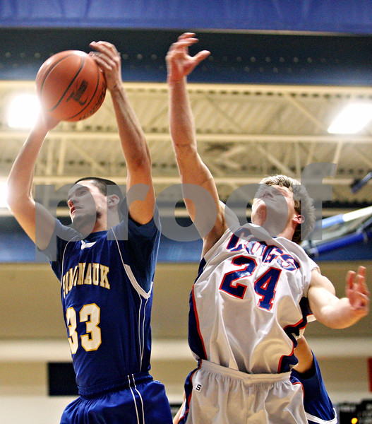 Rob Winner – rwinner@daily-chronicle.com<br /> <br /> Somonauk's Cody Passero (33) and Genoa-Kingston's Robert Thurlby (24) go up for a rebound during the first quarter in Genoa, Ill. on Tuesday, Jan. 25, 2011.