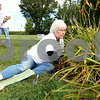 Kyle Bursaw – kbursaw@shawmedia.com<br /> <br /> Bonnie Anderson removes weeds at dead pieces of plants in the back of Heritage Woods in DeKalb, Ill. on Thursday, Sept. 8, 2011, while volunteering on the Day of Caring sponsored by the Kishwaukee United Way.