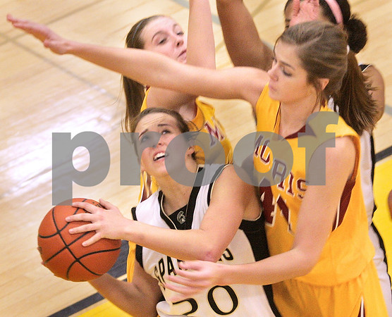 Kyle Bursaw – kbursaw@daily-chronicle.com<br /> <br /> Sycamore's Ashley Berlinski goes for a shot as Morris' Laney Torkelson defends in the first half of the game. Morris defeated Sycamore 27-23 on Friday, Jan. 7, 2011.