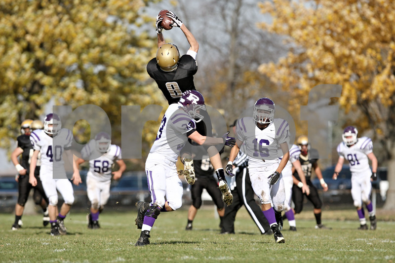 Rob Winner – rwinner@shawmedia.com<br /> <br /> Sycamore wide receiver Ben Niemann (8) hauls in a Ryan Bartels pass during the second quarter of a Class 5A playoff game in Sycamore, Ill., on Saturday, Nov. 5, 2011. Rochelle defeated Sycamore, 21-16.