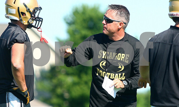 Kyle Bursaw – kbursaw@daily-chronicle.com<br /> <br /> Sycamore head coach Joe Ryan talks to one of his players during the first day of football practice Wednesday morning at Sycamore High School.<br /> <br /> Wednesday, Aug. 10, 2011.