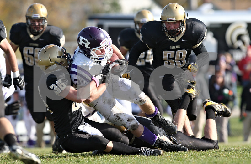 Rob Winner – rwinner@shawmedia.com<br /> <br /> Sycamore's Scott Baker (36) wraps up Rochelle running back Will Metzger (23) during the third quarter of a Class 5A playoff game in Sycamore, Ill., on Saturday, Nov. 5, 2011. Rochelle defeated Sycamore, 21-16.