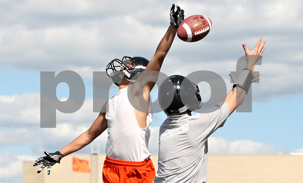 Rob Winner – rwinner@daily-chronicle.com<br /> <br /> Jake Young (left) breaks up a pass intended for Charles White during the first day of practice on Wednesday, Aug. 10, 2011, in DeKalb, Ill.