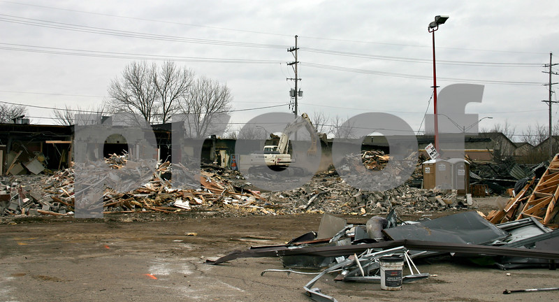Demolition of buildings on the corner of West Lincoln Highway and Annie Glidden Road is well underway, paving room for construction of a $2.5 million CVS/pharmacy building. The new facility will be located at 1022 W. Lincoln Highway. Molly's Eatery & Drinkery, which was formerly housed in the plaza, has plans to relocate to 1000 W. Lincoln Highway. <br /> <br /> By Nicole Weskerna - nweskerna@shawmedia.com