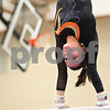 Kyle Bursaw – kbursaw@shawmedia.com<br /> <br /> Alyssa Lopez does her uneven bars routine during the warm-up period at DeKalb High School on Friday, Dec. 9, 2011.