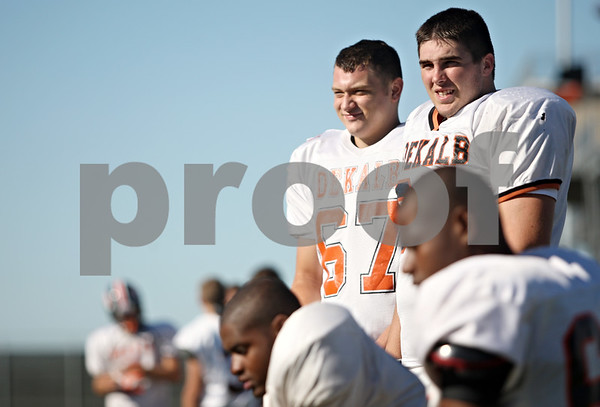 Rob Winner – rwinner@shawmedia.com<br /> <br /> DeKalb's Tucker Code (left) and Joe Diedrich watch the second team offense from the sidelines during practice on Tuesday, Sept. 6, 2011.